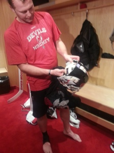 Martin Brodeur describes the artwork on his mask (c) 2014 Michelle Kenneth